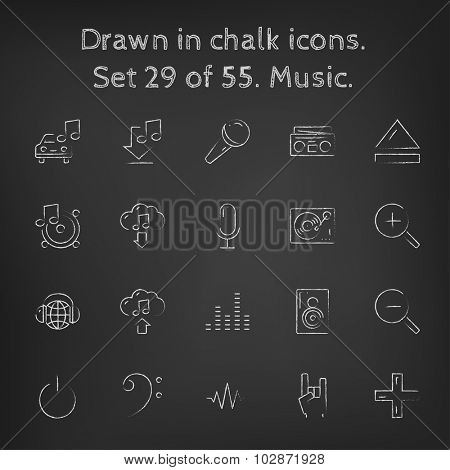 Music icon set hand drawn in chalk on a blackboard vector white icons on a black background.