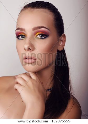 Beautiful Girl With Dark Hair And Extravagant Bright Makeup