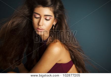 beautiful young woman with healthy and shiny long hair and makeup.