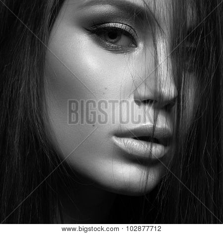 Beautiful woman with evening make-up and long straight hair . Smoky eyes. Fashion photo. Black white
