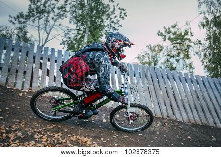 Cyclist riding a mountain bike downhill