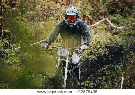 athlete rides on the mountain bike trail on earth