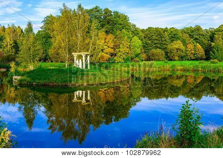 Autumn Nature With Colourful Trees, Green Grass Near Lake