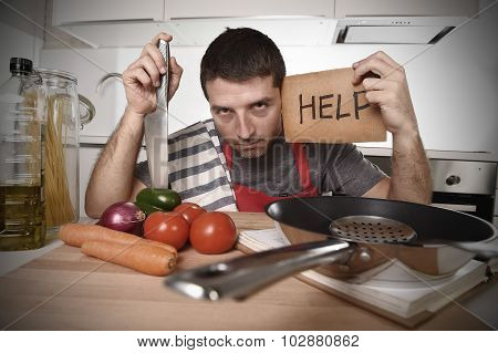 Young Man At Home Kitchen In Cook Apron Desperate In Stress And