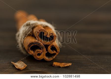 Cinnamon Sticks On Wooden Background, Close Up