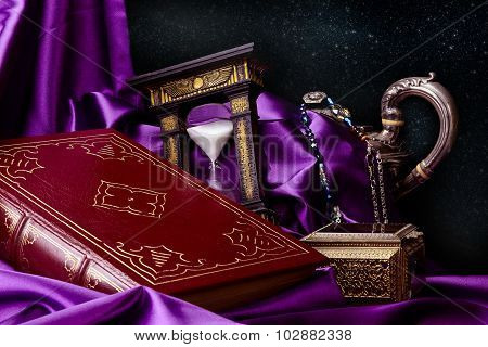 Closed Ancient Book With Treasures And Stars