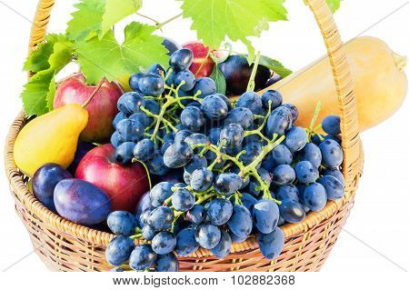 Basket With Ripe Fruit On A White Background