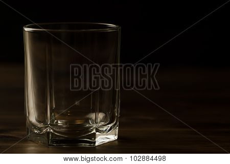 Glass Of Whiskey With Ice On A Wooden Table. Cognac, Brandy.