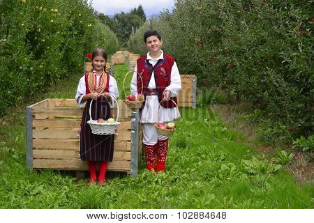 Resen, Macedonia. September, 27  2015- Boy And Girl In Traditional Clothes Posing With Apples During