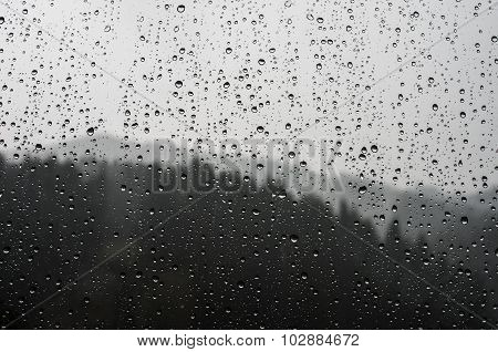 Raindrops On Glass On The Background
