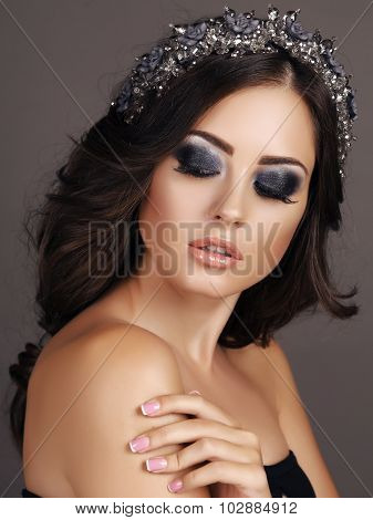 Sensual Woman With Dark Hair With Evening Makeup And Luxurious Headband