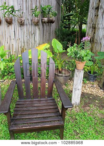 Wooden chair in green garden