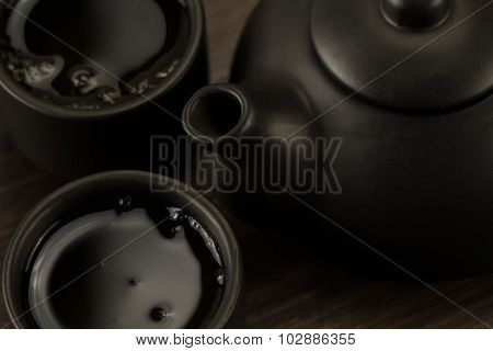 Black Teapot, Two Cups On Old Wooden Background. Close Up