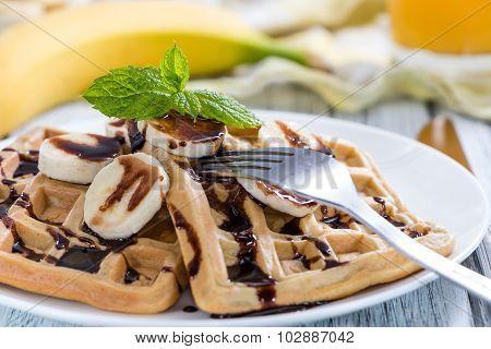 Breakfast (waffles With Bananas And Chocolate Sauce)