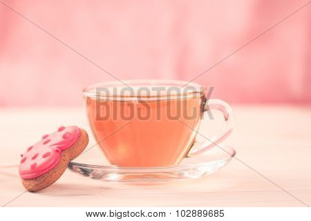 Delicious Fresh Cookies In The Shape Of A Heart On A White Plate On Wooden Background. A Cup Of Gree