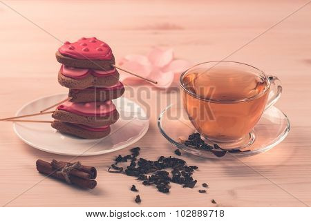Delicious Fresh Cookies In The Shape Of A Heart On A White Plate On Wooden Background. Cup Of Green