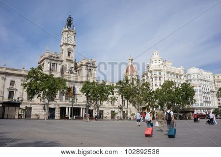 VALENCIA, SPAIN - SEPTEMBER 26, 2015: Tourist in the Ayuntamiento (City Hall) Plaza of Valencia. Valencia is the capital of the autonomous community of Valencia and the third largest city in Spain.