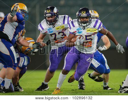 GRAZ, AUSTRIA - JUNE 27, 2014: RB Anthony Stevenson (#25 Vikings) runs with ball during an Austrian football league game.