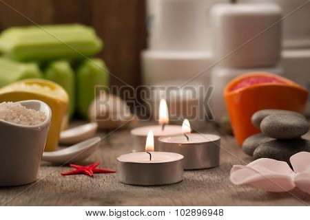 Spa Composition With Sea Salt, Candles, Soap, Shells, Creams For Face On Wooden Background. Aromathe