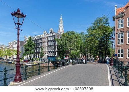 Bridge With Traditional Lantern Over Amsterdam Canal, The Netherlands