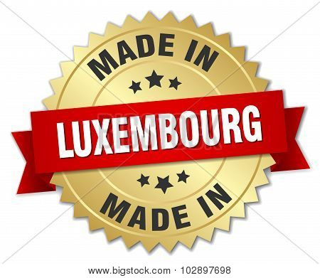 Made In Luxembourg Gold Badge With Red Ribbon