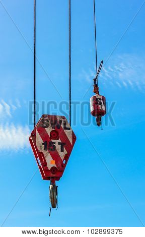 Hooks Crane And Blue Sky Background.