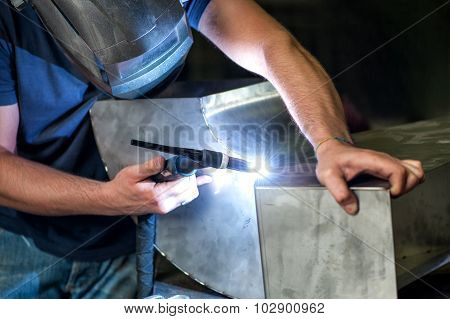 Metalworker Welding Two Metal Components