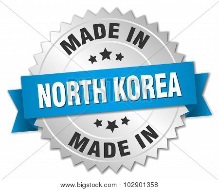 Made In North Korea Silver Badge With Blue Ribbon