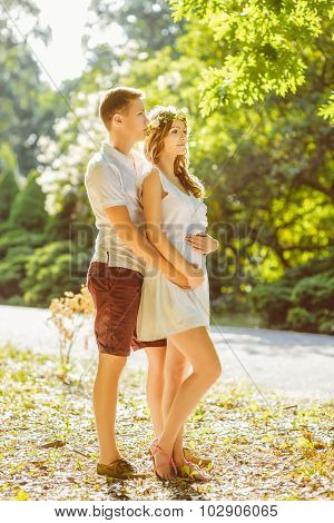 Portrait of beautiful loving couple awaiting baby. Husband and wife maternity expecting a child. War