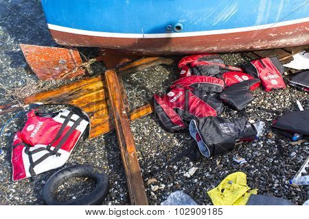 KOS, GREECE - SEP 27, 2015: Life Jackets discarded on a beach. Kos island is located just 4 kilometers from the Turkish coast and refugees come from Turkey in an inflatable boat.