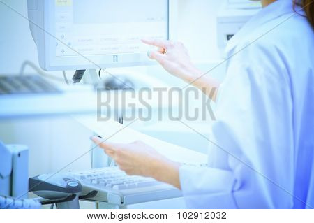 Asia Woman Scientist Working With Device For Blood Analysis
