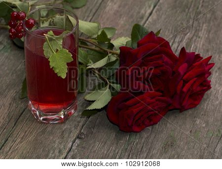 Bouquet Of Red Roses And Glass With Red Drink