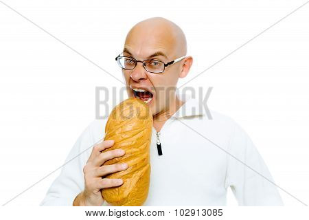 Hungry Bald Man Bites A A Large Loaf. Studio. Isolated