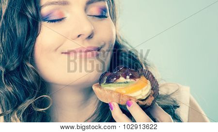 Woman Closed Eyes Holds Cake In Hand