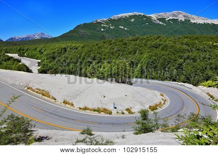 Winding road in Chilean Patagonia, covered volcanic ash
