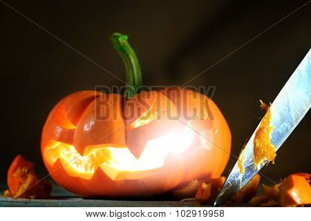 Carving a Halloween jack o' lantern