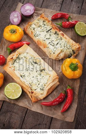 Phyllo pastry filled with cheese and spinach, traditional balkans fast food meal