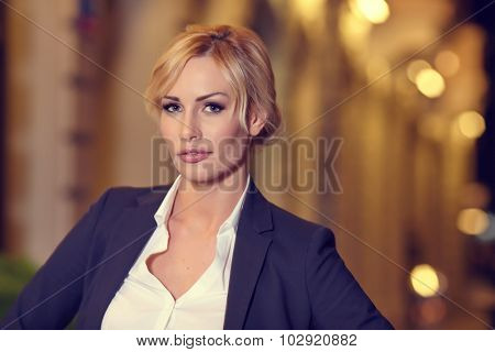Portrait of a  female businesswoman in night city. Close-up, shallow DOF.