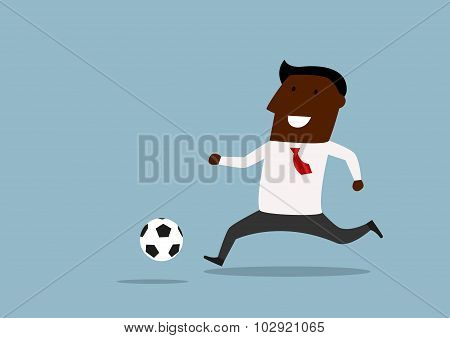 Black businessman dribbling with ball
