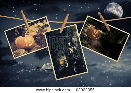 Halloween postcards hanging on line in night sky
