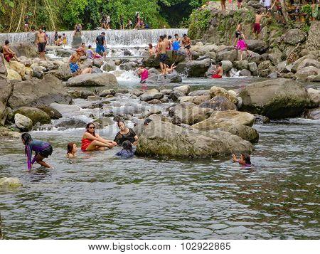 Filipino Families Swim In A River