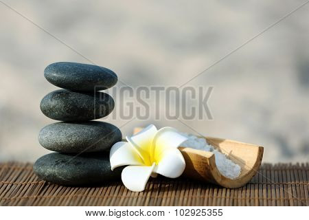Spa composition with flower on sand beach close up