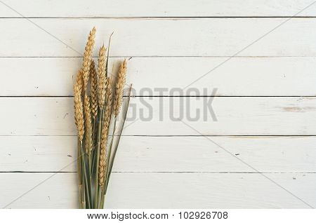Sheaf Of Spikelets Of Wheat On The Wooden Table Closeup