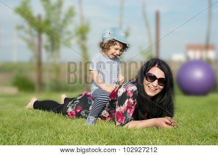 Mother And Son Having Fun Outside