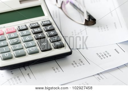 Financial Statement With Calculator And Glasses