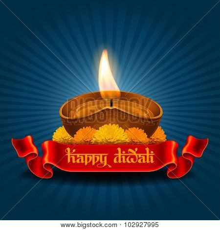 Vector illustration of burning oil lamp diya on Diwali Holiday, ancient Hindu festival of lights, on dark blue background. Original calligraphic inscription Happy Diwali and space for your text.