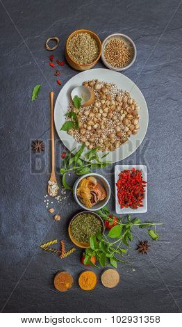 Spices And Herbs In Metal Bowls Background For Decorate And Design Project.