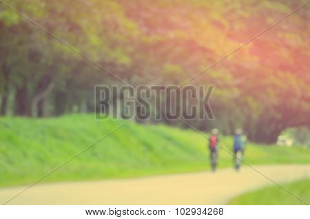 Blur People Riding Bicycle Abstract Background.