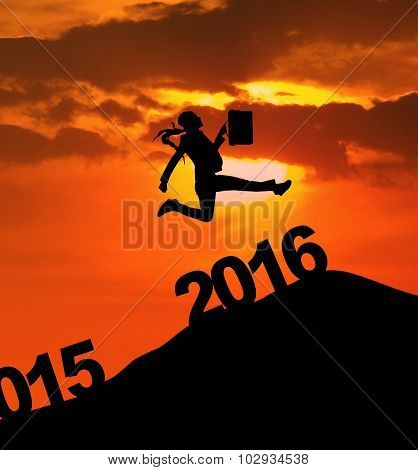 Businesswoman Jumping Over 2016 Numbers