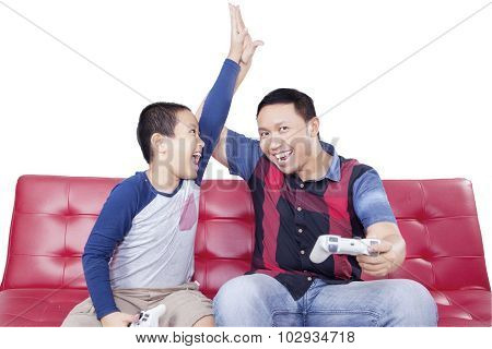 Cheerful Boy Playing Video Game With Dad